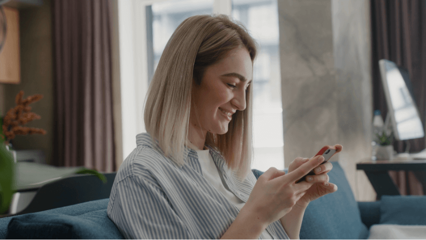 Woman smiling and using smart phone